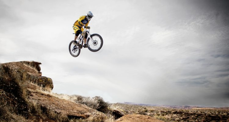 mountain-biker-jumping-over-rocks-1